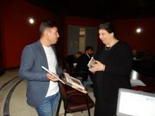 Dr Noorah Al Gailani gifting books to the Basrah Museum Library
